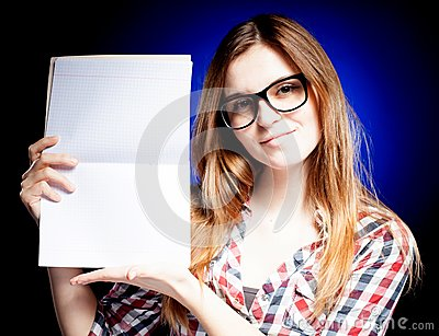 Happy young girl with nerd glasses holding exercise book