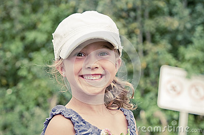 Happy young girl in the park smiling