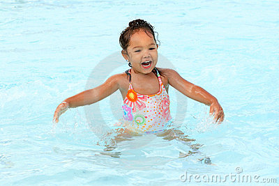 Happy young girl in a pool