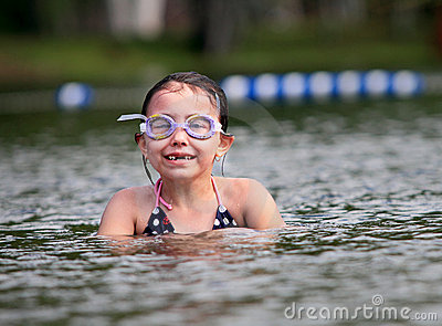 Happy young girl swimming