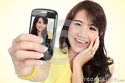 Happy young girl take self portrait
