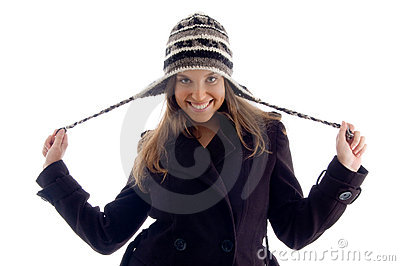 Happy young girl wearing winter clothes