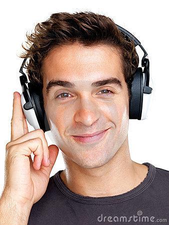 Happy young guy listening to peaceful music