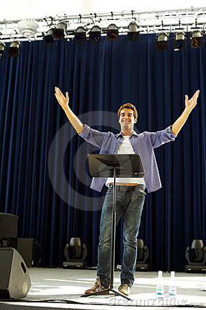 Happy young guy performing on stage