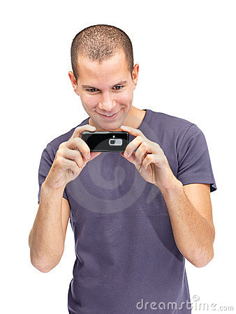 Happy young guy taking picture on cell phone