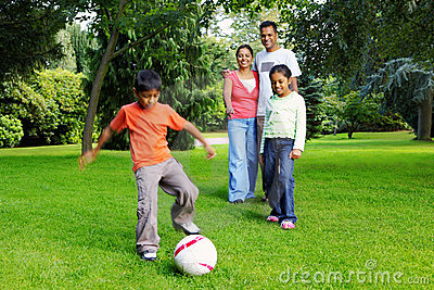 Happy Young Indian Family Playing Football Outside Stock ...