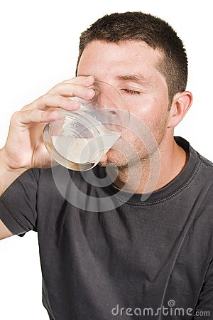 Happy Young  Man drinking Milk