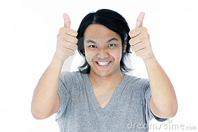 Happy young man giving thumbs up sign