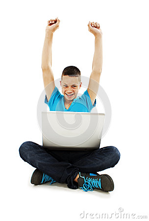 Happy young man with hand raised in air
