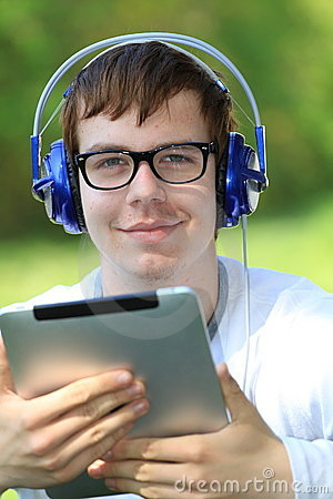Happy young man holding an ipad