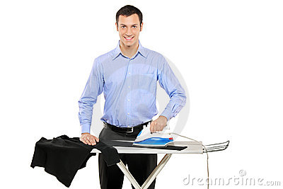 happy-young-man-ironing-his-clothes-16510811.jpg