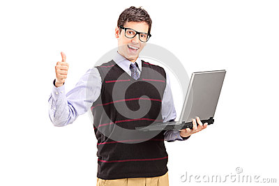 Happy young man with laptop showing thumb up