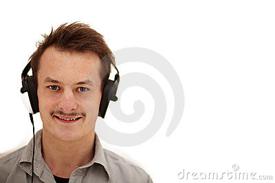 Happy young man looking at you and listening