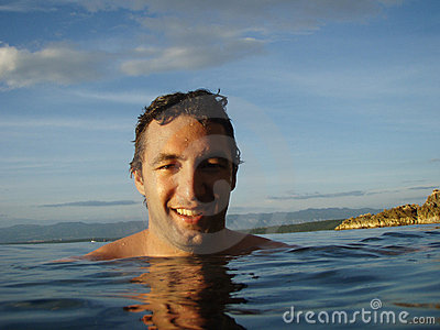 Happy young man in the sea