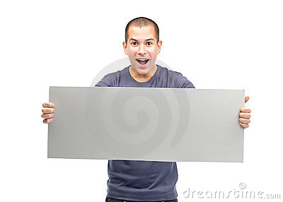 Happy young man showing an empty billboard