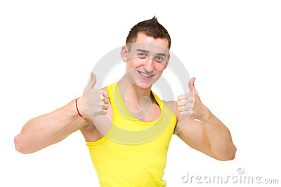 Happy young man with thumbs up gesture