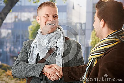 Happy young men shaking hand