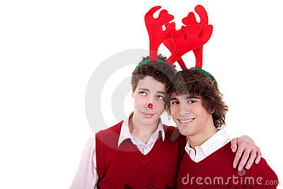 Happy young men wearing reindeer horns