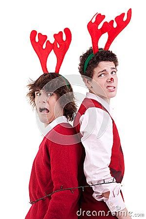 Happy young men wearing reindeer horns