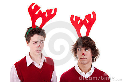 Happy young men wearing reindeer horns, admired