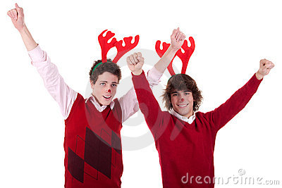 Happy young men wearing reindeer horns, with arms
