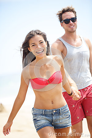 Happy young modern couple on beach