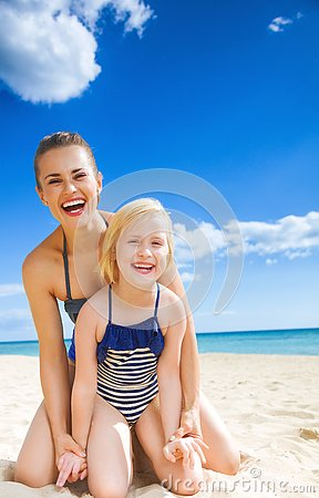 Free Happy Young Mother And Daughter On Seacoast Having Fun Time Royalty Free Stock Photos - 93877528
