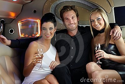 Happy young people in limousine