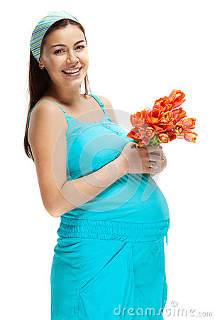 Happy young pregnant woman in blue