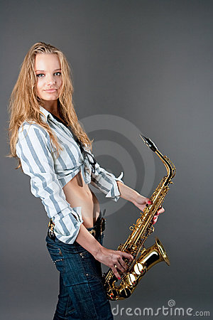 Happy young pretty blonde girl with sax