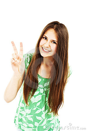 Happy young teenager girl showing victory sign