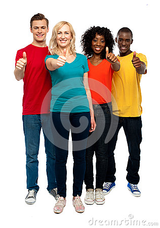 Happy young teens gesturing thumbs up