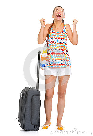 Happy young tourist woman with wheel bag enjoing vocation