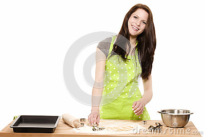 Happy young woman baking for christmas