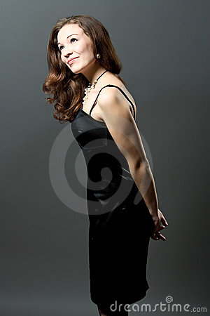 Happy young woman in black evening dress