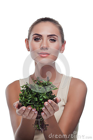 Happy young woman with with a bundle of fresh mint
