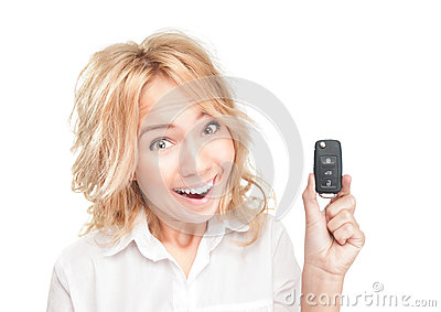 Happy young woman with car key on white.
