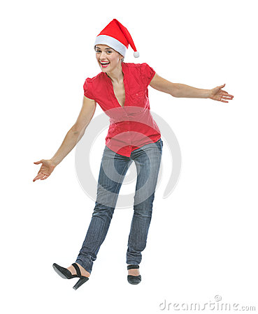 Happy young woman in Christmas hat funny posing