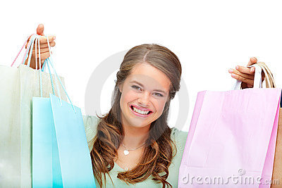 Happy young woman with colorful shopping bags
