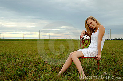 Happy young woman in country