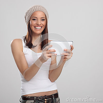 Happy young woman and digital tablet