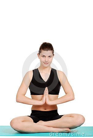 Happy young woman doing yoga