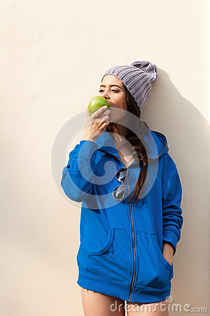 Happy Young Woman Eating Apple
