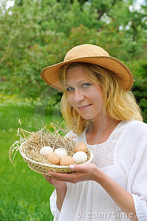 Happy young woman and eggs