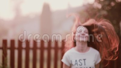 Happy young woman enjoying nature, turning, having fun, smiling, jumping of joy. Lady s hair flutters on wind. Happy attractive young woman enjoying nature stock footage