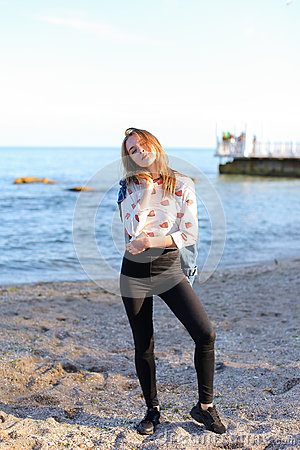 Free Happy Young Woman Enjoys Sunny Weather And Posing On Shore Of Bl Stock Photos - 98034713