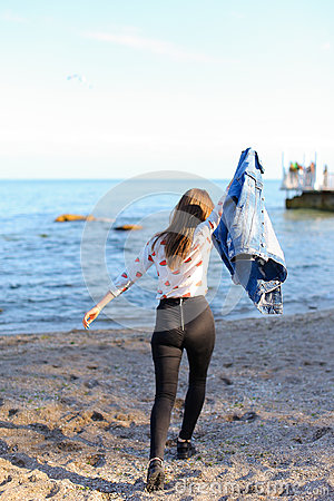Free Happy Young Woman Enjoys Sunny Weather And Posing On Shore Of Bl Stock Photos - 98369833