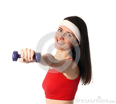 Happy young woman exercising with a dumbbell