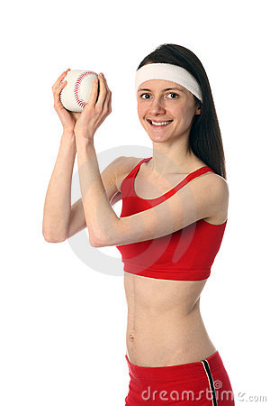 Happy young woman exercising with a small ball