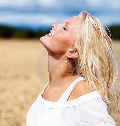 Happy young woman with eyes closed